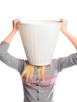 Young woman wearing lampshade on her head. Young head is a place